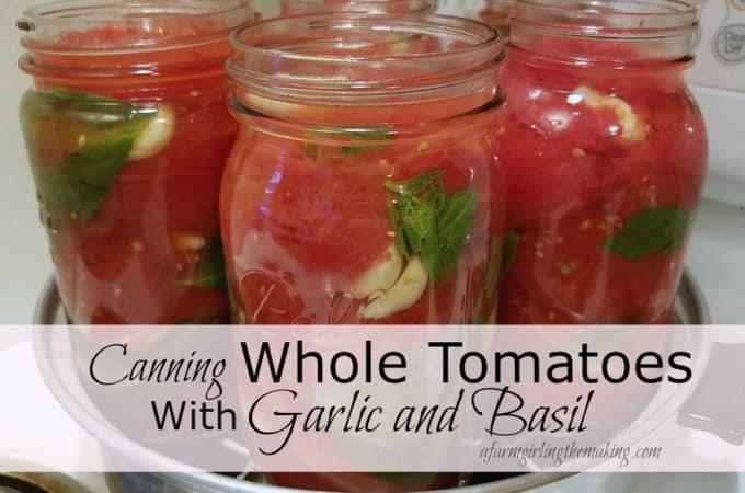 canning whole tomatoes with garlic and basil