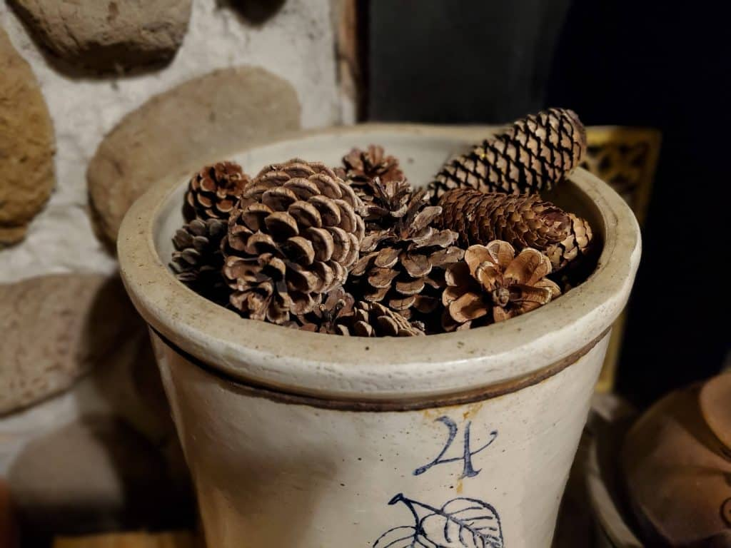 scented pine cones in an antique crock