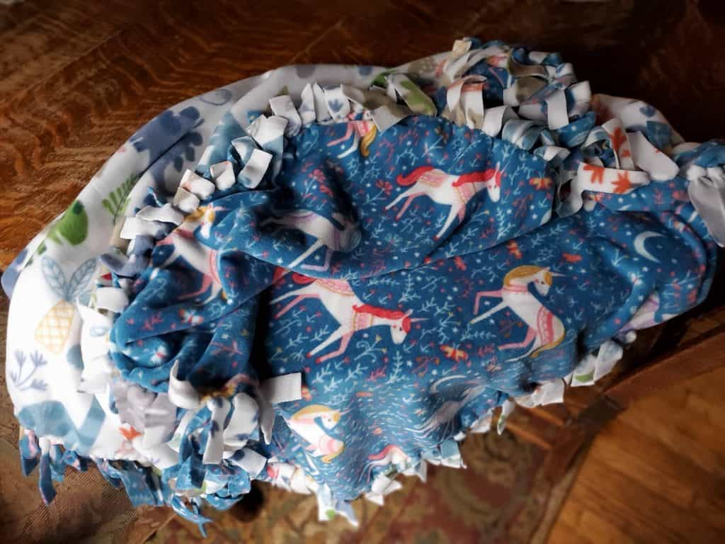 practical gifts for homesteading kids are first homemade items like a no tie fleece blanket
