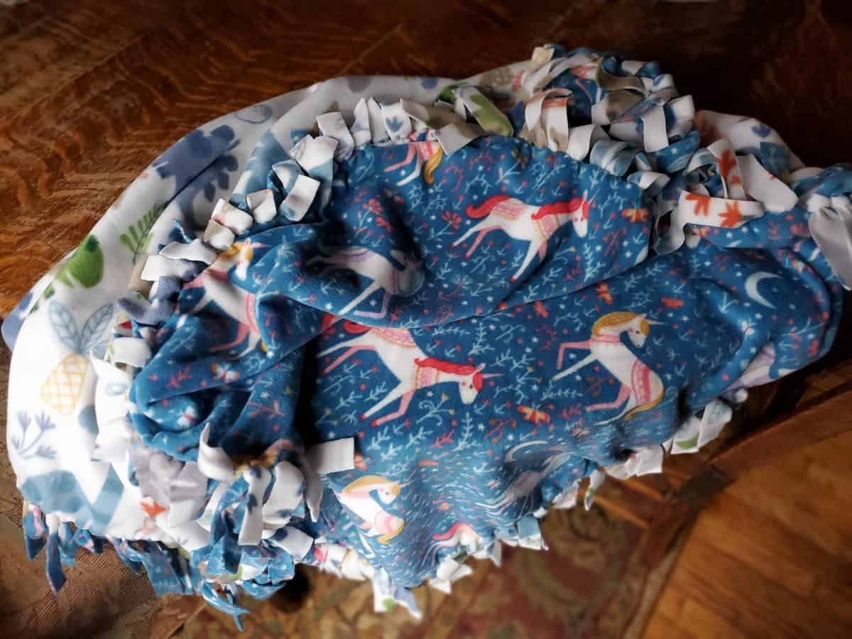 a no sew fleece blanket is a great practical gift for homesteading kids