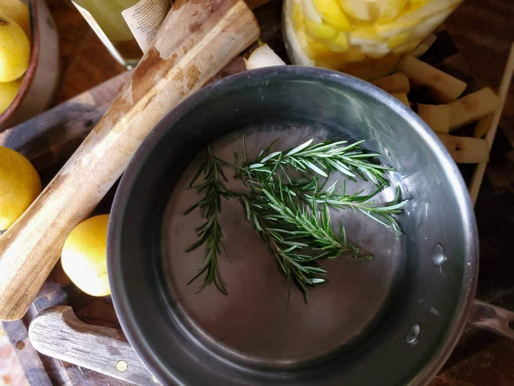 saucepan to make a rosemary simple syrup which is partnered with an Asian pear shrub cocktail.