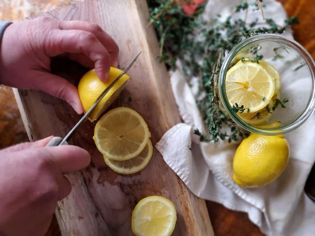 Slicing lemons to make a natural cough syrup.